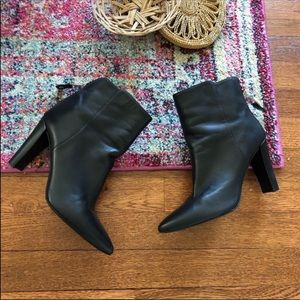 Stuart Weitzman black leather zipper booties